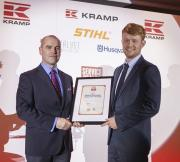 Husqvarna's UK Sales & Marketing Director, Ken Brewster presenting the Garden Machinery Dealer of the Year Award to Chris Garlick of Garlick Garden Machinery at the 2017 event