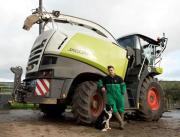 Winnie with owner Josh Sibley and the forage harvester she went under pictured in The Bridport & Lyme Regis News. Pic: BNPS