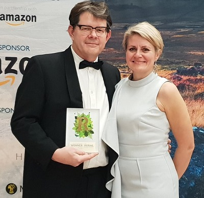 TAP owners Duncan Murray-Clarke and Emma Craigie with the award for Best Rural Digital, Communications or Media Business