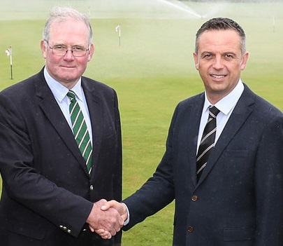Royal St George's chairman of greens Chris Healey (left) shakes hands with Reesink's Robert Jackson