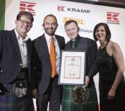 L-R: Service Dealer owner Duncan Murray-Clarke and Kramp UK Sales Director Des Boyd join Pete and Emma McArthur to celebrate their Overall Dealer of the Year win at last year's ceremony