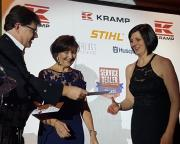 A charity raffle was held for Maggie's at the Awards. Here Service Dealer owner Duncan Murray-Clarke and Trish Biddle present a prize to Emma McArthur