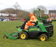 Street Scene team member Tony Boden operating one of South Staffordshire Council's new John Deere 1570 front rotary mowers at the start of the grass cutting season in March.