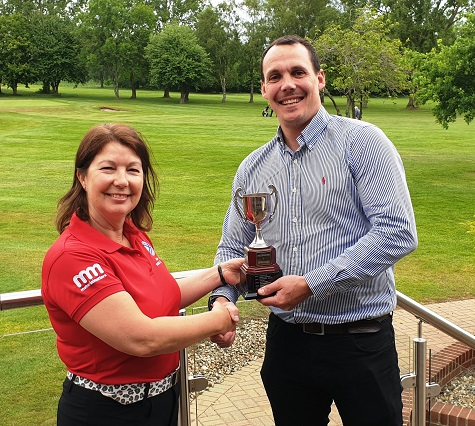 Matthew Mears presenting the ClearWater Cup to Managers Captain Jane Harfield 2019