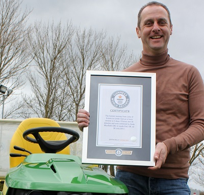 Andy Maxfield with his GUINNESS WORLD RECORDS certificate for the fastest journey from John O'Groats to Land's End on a lawn mower, achieved on 30 July 2017