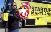 Mike Binko, CEI Advisory Board member poses in front of the Startup Maryland bus.