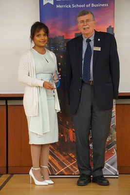 Farheen Nabi and Phil Korb with the Finance Award