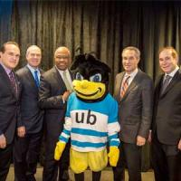 Edward and Mildred Attman's four sons and UB President Kurt Schmoke