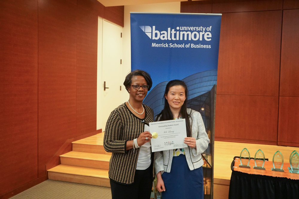 Associate Professor of Accounting Jan Williams and Keli Zhang, M.S. '17, pose after Keli won the MACPA Outstanding Student Award